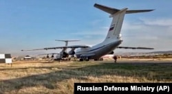 Russian military planes with peacekeeper-soldiers on board are seen after landing at Erebuni Airport outside Yerevan, Armenia on November 10, 2020.