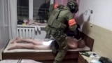 BELARUS -- A Belarusian KGB officer detains a Russian man in a sanitarium outside in Minsk, July 29, 2020