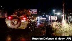 Russian military vehicles enter Stepanakert (Khankendi), the main town in the disputed region of Nagorno Karabakh, on November 12, 2020.