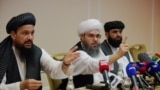 Taliban representatives Abdul Latif Mansoor (left), Shahabuddin Delawar, and Suhail Shaheen attend a July 9, 2021 news conference in Moscow, Russia.