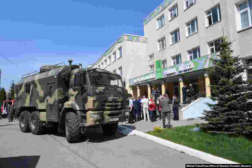 Law enforcement officers on May 11, 2021 work outside of Kazan's School No. 175, where at least nine people were killed and 21 wounded when a suspected 19-year-old gunman opened fire on the facility, according to officials.
