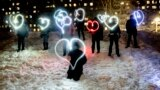 RUSSIA -- People draw hearts with their cellphones flashlights in support of jailed opposition leader Aleksei Navalny and his wife Yulia Navalnaya, in Moscow, February 14, 2021