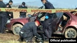 Police inspect the car allegedly used to kidnap Aizada Kanatbekova,