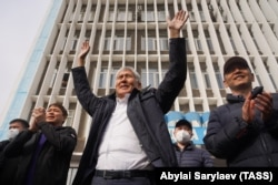 Former Kyrgyz President Almazbek Atambaev attends an October 9, 2020 rally of his supporters outside the Bishkek offices of the company, Media Forum, that hosts the Aprel TV Channel, owned by Atambaev.