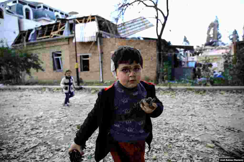 Five-year-old Bahtiyar Elnur, who was injured during a blast, plays with his sister, Sehla, in the Azerbaijani city of Ganja on October 11, 2020.