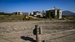 An unexploded, Russian-made BM-30 Smerch rocket is seen on October 12, 2020 in the outskirts of Stepanakert, known to Azerbaijanis as Khankendi, the main town in the breakaway region of Nagorno-Karabakh. Though Russia is a co-chair of the Organization for Security and Cooperation in Europe group coordinating negotiations between Armenia and Azerbaijan, it has sold weapons to both sides of the conflict.
