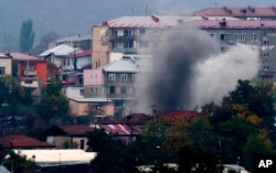 Smoke rises after shelling by Azerbaijan's artillery on Stepanakert (Khankendi), the main town in the breakaway region of Nagorno-Karabakh, on November 4, 2020.