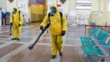 RUSSIA -- Specialists wearing personal protective equipment (PPE) spray disinfectant while sanitizing the Rizhsky Railway Station, one of the measures to curb the spread of the coronavirus disease (COVID-19), in Moscow, June 17, 2021