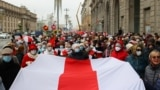 BELARUS -- Belarusian pensioners carrying a former white-red-white flag of Belarus parade through the streets during a rally to demand the resignation of authoritarian leader and new fair election, in Minsk, November 2, 2020